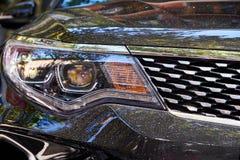 Προβολείς του μαύρου αυτοκινήτου στοκ φωτογραφία με δικαίωμα ελεύθερης χρήσης