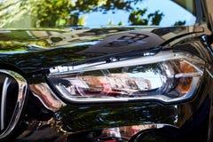 Προβολείς του μαύρου αυτοκινήτου στοκ εικόνα με δικαίωμα ελεύθερης χρήσης