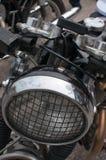 Προβολέας μοτοσικλετών με μια σχάρα Στοκ Εικόνα