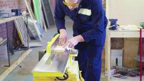 Προγραμματισμένος ξυλουργός πίνακας στην παλαιά μηχανή φιλμ μικρού μήκους
