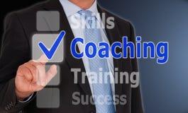 Προγύμναση - διευθυντής με το κουμπί οθονών επαφής στοκ φωτογραφία
