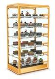 Προθήκη γυαλιού για το ψήσιμο, που γεμίζουν cupcakes, και τα κέικ Στοκ εικόνα με δικαίωμα ελεύθερης χρήσης