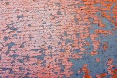 Προκαλεσμένη σκασίματα δομή του πορτοκαλιού leatherette ως υπόβαθρο Στοκ Εικόνες