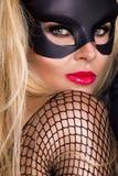 Προκλητική γυναίκα με τα μεγάλα στήθη, που φορούν ένα μαύρο λαγουδάκι Πάσχας μασκών Στοκ εικόνες με δικαίωμα ελεύθερης χρήσης