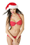Προκλητικός αρωγός santa bikini Στοκ Φωτογραφίες
