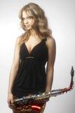 Προκλητικές ελκυστικές γυναίκες με το saxophone Στοκ Εικόνα
