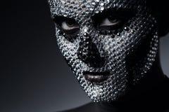 Προκλητική γυναίκα με το πρόσωπο κρανίων των rhinestones Στοκ φωτογραφία με δικαίωμα ελεύθερης χρήσης