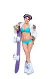 Προκλητική ντυμένη γυναίκα με το σνόουμπορντ στοκ φωτογραφία