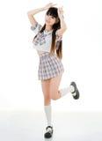 Προκλητικός ασιατικός σπουδαστής κοριτσιών στη σχολική στολή Στοκ Εικόνες
