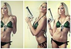 Προκλητικό ξανθό πυροβόλο όπλο εκμετάλλευσης γυναικών Στοκ Φωτογραφία