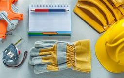 Προστατευτική ζώνη εργαλείων μολυβιών σημειωματάριων καπέλων γαντιών σκληρή που μετρά το TA Στοκ Εικόνες