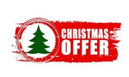 Προσφορά Χριστουγέννων και χριστουγεννιάτικο δέντρο στο κόκκινο συρμένο έμβλημα Στοκ φωτογραφία με δικαίωμα ελεύθερης χρήσης