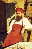Προϊστάμενος ατόμων με την κυλώντας καρφίτσα στοκ φωτογραφία