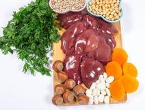 Προϊόντα που περιέχουν το σίδηρο (ferrum) στο λευκό healthy product Στοκ Εικόνα