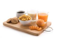 Πρόγευμα - ηπειρωτικό πρόγευμα, φρούτα, δημητριακά και πορτοκαλί jui Στοκ Φωτογραφία