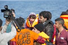 Πρόσφυγες που φθάνουν στην Ελλάδα στη βάρκα λέμβων από την Τουρκία Στοκ Φωτογραφίες