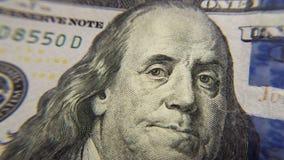Πρόσωπο κινηματογραφήσεων σε πρώτο πλάνο λογαριασμών εκατό δολαρίων του Ben Franklin Στοκ Εικόνες