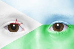 Πρόσωπο με τη σημαία του Τζιμπουτί στοκ φωτογραφία