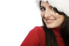 Πρόσωπο μιας χαμογελώντας γυναίκας σε ένα καπέλο Santa Στοκ φωτογραφίες με δικαίωμα ελεύθερης χρήσης