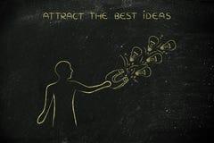 Πρόσωπο που προσελκύει lightbulbs (ιδέες) με το μαγνήτη, δημιουργικότητα con Στοκ Εικόνες