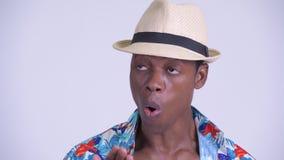 Πρόσωπο του νέου αφρικανικού ατόμου τουριστών που φαίνεται συγκλονισμένου φιλμ μικρού μήκους