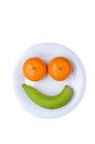 Πρόσωπο φρούτων διασκέδασης με την μπανάνα και τα πορτοκάλια. Στοκ Εικόνες