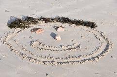 Πρόσωπο Smiley στην άμμο Στοκ Φωτογραφία