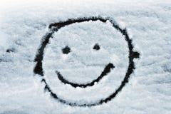 Πρόσωπο Smiley στο χιόνι στοκ φωτογραφία με δικαίωμα ελεύθερης χρήσης