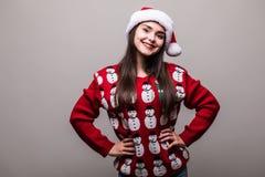 Πρότυπα καπέλο santa ένδυσης κοριτσιών και πουλόβερ Χριστουγέννων Στοκ Εικόνα