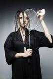 Πρότυπο κοριτσιών με μια ρακέτα και flounce Στοκ φωτογραφία με δικαίωμα ελεύθερης χρήσης