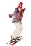 Πρότυπο φορώντας χειμερινό κοστούμι που κρατά ένα σνόουμπορντ Στοκ Εικόνα