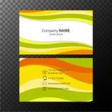 Πρότυπο Businesscard με τις πορτοκαλιές και πράσινες κυματιστές γραμμές διανυσματική απεικόνιση