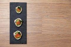 Πρόχειρα φαγητά σολομών στα κοχύλια Στοκ Εικόνα