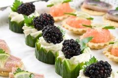 πρόχειρα φαγητά συμβαλλόμ&e Στοκ Εικόνες