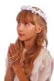 πρώτο κορίτσι κοινωνίας που πηγαίνει ιερό Στοκ Φωτογραφία
