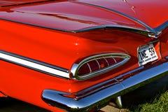 Πτερύγια ενός παλαιού αποκατεστημένου κοκκίνου 1959 Chevy Στοκ εικόνα με δικαίωμα ελεύθερης χρήσης