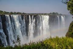 Πτώσεις Βικτώριας σε μια ηλιόλουστη ημέρα στη Ζιμπάμπουε Στοκ Εικόνα