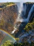 πτώσεις Βικτώρια Μια γενική άποψη με ένα ουράνιο τόξο Εθνικό πάρκο Εθνικό πάρκο mosi-OA-Tunya και περιοχή παγκόσμιων κληρονομιών  Στοκ εικόνα με δικαίωμα ελεύθερης χρήσης