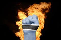 Πυγμή πυρκαγιάς με τη εθνική σημαία της Μποτσουάνα Στοκ φωτογραφία με δικαίωμα ελεύθερης χρήσης