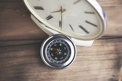 Πυξίδα και ρολόι Στοκ Εικόνες