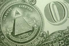 Πυραμίδα, μάτι της πρόνοιας, και Ο ΈΝΑ στην πλάτη ενός Αμερικανού ενιαίου στοκ εικόνα