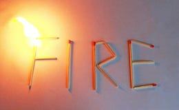 Πυρκαγιά λέξης που πιάνει την πυρκαγιά, που καίει τη φλόγα στοκ φωτογραφίες με δικαίωμα ελεύθερης χρήσης