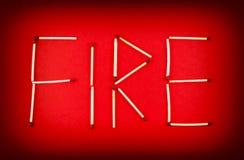 ΠΥΡΚΑΓΙΑ λέξης φιαγμένη από matchsticks Στοκ Εικόνα