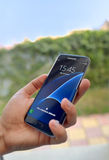 Πυροβοληθείς της ανθρώπινης άκρης γαλαξιών της Samsung εκμετάλλευσης χεριών S7 στοκ φωτογραφία με δικαίωμα ελεύθερης χρήσης