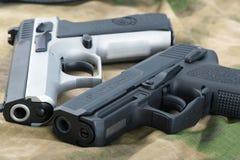 πυροβόλα όπλα που τίθεντ&alph Στοκ Εικόνες