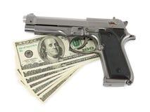 Πυροβόλο όπλο και χρήματα Στοκ Εικόνα