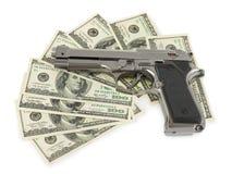 Πυροβόλο όπλο και χρήματα Στοκ φωτογραφία με δικαίωμα ελεύθερης χρήσης