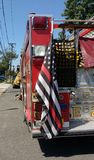 Πυροσβεστική αντλία με τη λεπτή αμερικανική σημαία κόκκινων γραμμών, Rutherford, Νιου Τζέρσεϋ, ΗΠΑ Στοκ φωτογραφία με δικαίωμα ελεύθερης χρήσης