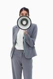 Πωλήτρια που χρησιμοποιεί megaphone Στοκ Εικόνες