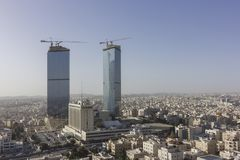 Πόλη του Αμμάν - όμορφος χειμώνας ουρανού πύργων πυλών της Ιορδανίας Στοκ Φωτογραφίες